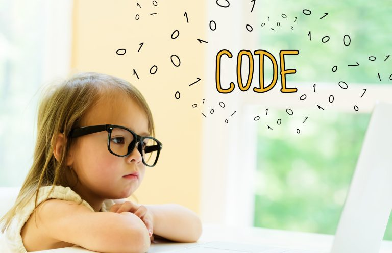 Code text with little girl using her laptop